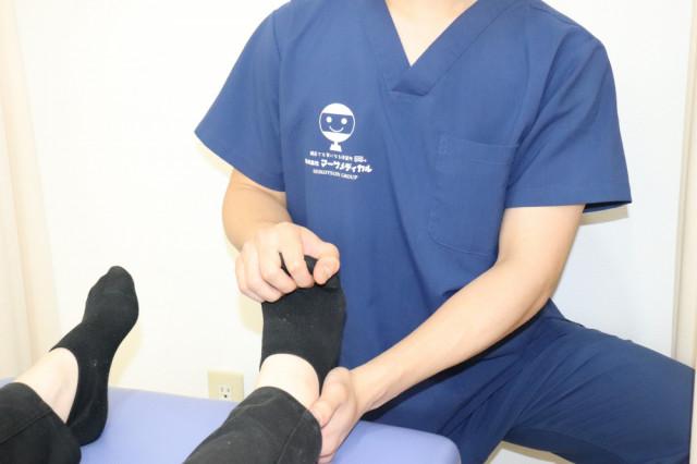 アキレス腱の包帯固定の写真